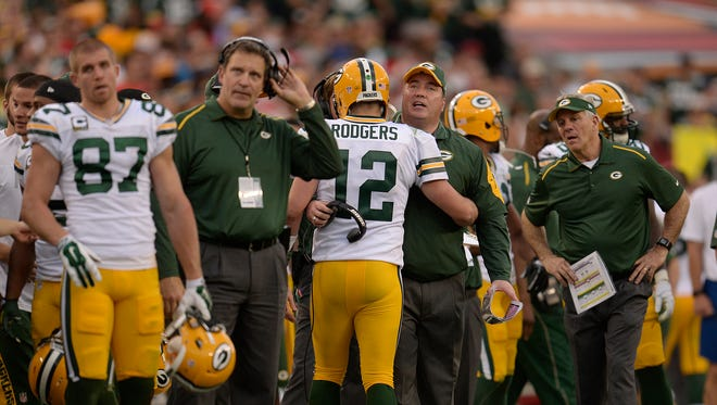 Green Bay Packers quarterback Aaron Rodgers hugs head coach Mike McCarthy after the Packers scored a touchdown against the Tampa Bay Buccaneers during Sunday's game at Raymond James Stadium in Tampa, Fla
