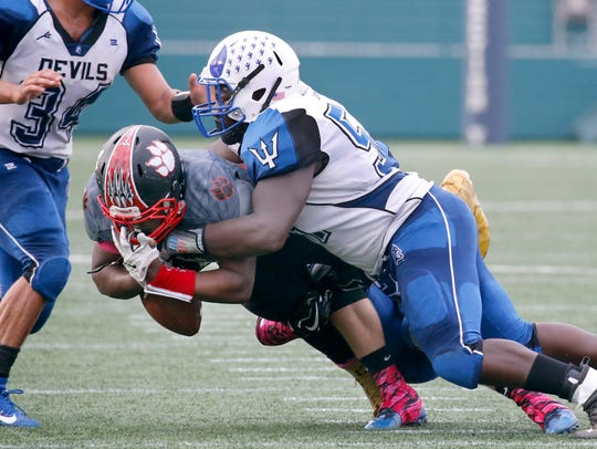 Wilson's Duvar Douglas is tackled by Batavia's Joshua Barber in the second quarter in a non-league game last season in Rochester.