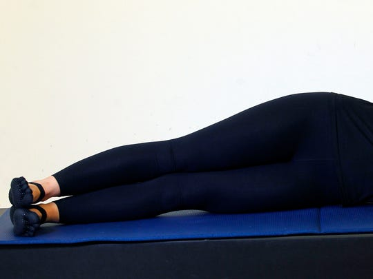 Erin Stern shows the starting position for the Pilates exercise, side leg series.
