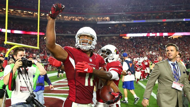 Larry Fitzgerald (11) celebrates his game-winning touchdown.