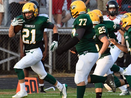 Pennfield RB Grant Petersen (21) breaks through Marshall