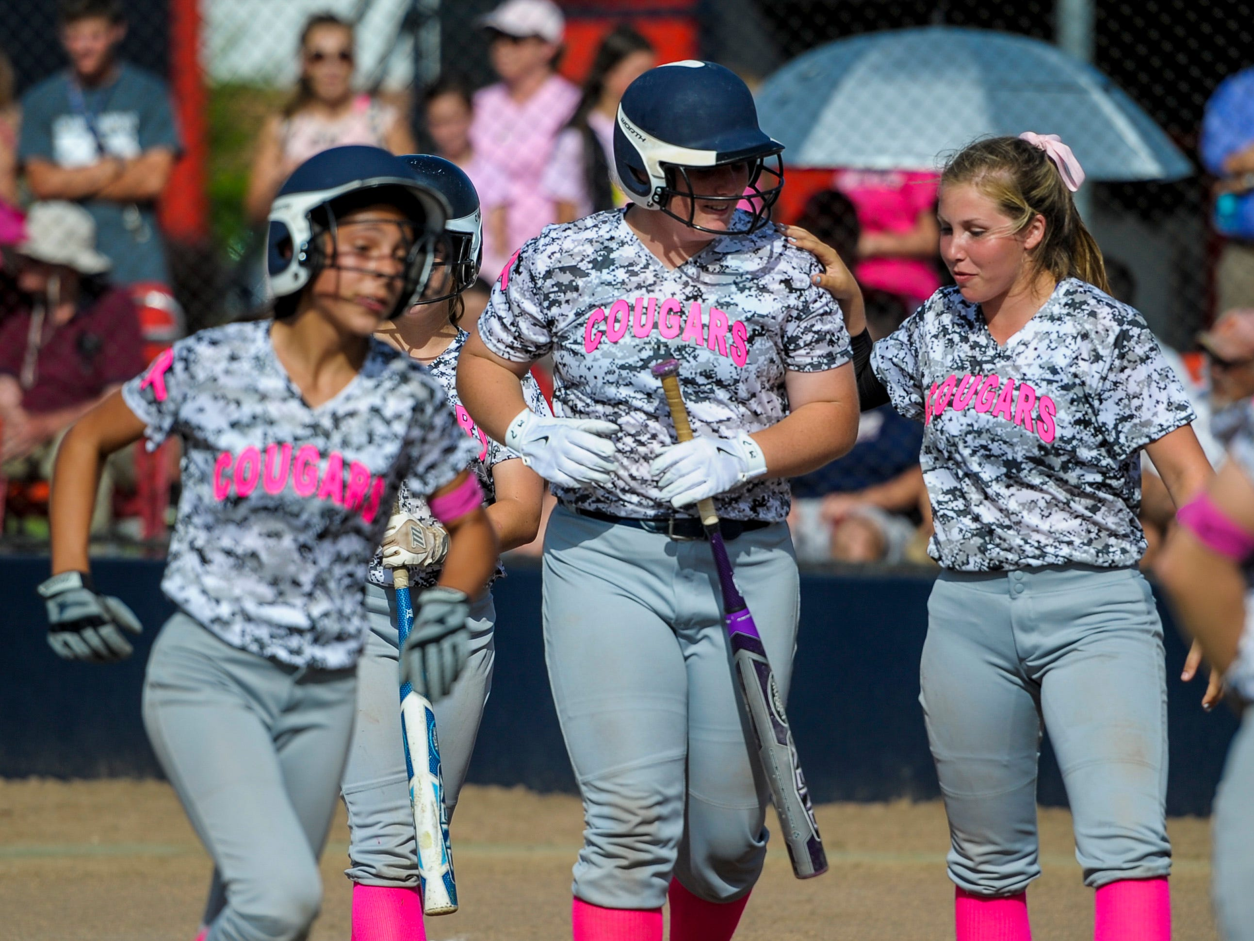 St. Thomas More catcher Bailey Hemphill (16) celebrates with teammates after hitting a two-run home run during the third inning Wednesday at Teurlings Catholic.