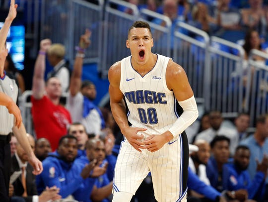 Magic forward Aaron Gordon reacts after making a basket against the Heat during the first quarter Oct. 18.