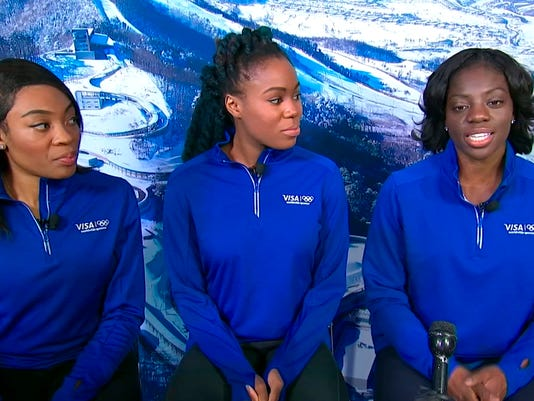 In this Dec. 7, 2017 image take from video, Nigerian boblsedder Seun Adigun, right, speaks as teammates Ngozi Onwumere, left, and Akuoma Omeoga listen during an interview in New York. The trio will represent Nigeria as the country fields its first-ever bobsled team at the Winter Olympics in Pyeongchang. The team is also a first, men's or women's, for the entire continent of Africa. (AP Photo)