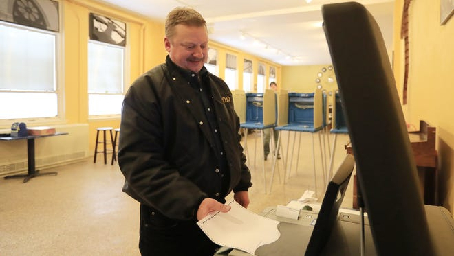 Don Socha of Green Bay casts his  primary election ballot Tuesday at St. Joseph's Parochial School in Green Bay.
