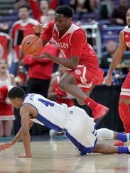 Bradley Braves's Donte Thomas (1) leaps over Drake's