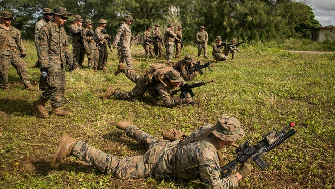 Marines with India Company, Battalion Landing Team, 3rd Battalion, 5th Marines, launch into the prone position during a grenade-throwing drill at Andersen South Air Force Base, Guam, September 3, 2017. Marines with BLT 3/5 train regularly in different environments to maintain their readiness as the Ground Combat Element of the 31st Marine Expeditionary Unit.