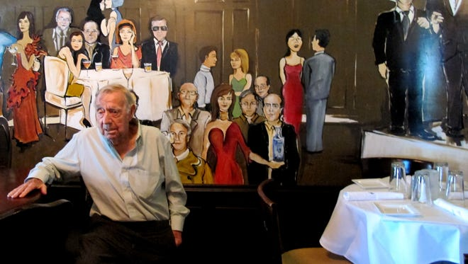 A mural featuring depictions of some of Naples movers and shakers includes Cloyde Pate, left, managing partner of the new St. Germain Steakhouse, which is replacing the longtime Stoney's Steakhouse in Naples' Bayfront.
