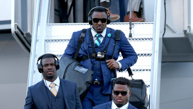 Carolina Panthers outside linebacker Thomas Davis exits a plane during team arrivals at the Mineta San Jose International Airport in preparation of Super Bowl 50 against the Denver Broncos.