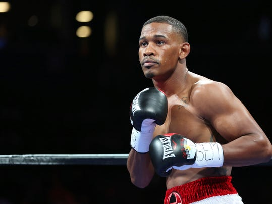 FILE - In this Aug. 1, 2015, file photo, boxer Daniel Jacobs squares off against Sergio Mora during their WBA middleweight title fight at the Barclays Center in New York. Jacobs likes to think of himself as New York's resident boxer. He'll be spreading his word on Saturday night when he fights Luis Arias at the revamped Nassau Coliseum on Long Island.  (AP Photo/Gregory Payan, File)