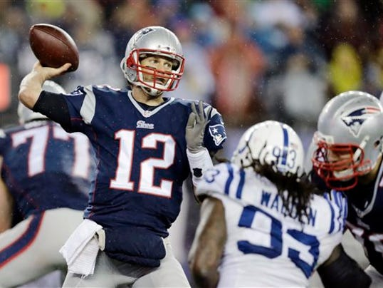 """FILE - In this Jan. 18, 2015, file photo, New England Patriots quarterback Tom Brady (12)  passes against the Indianapolis Colts during the second half of the NFL football AFC Championship game in Foxborough, Mass. An NFL investigation has found that New England Patriots employees likely deflated footballs and that quarterback Tom Brady was """"at least generally aware"""" of the rules violations. The 243-page report released Wednesday, May 6, 2015, said league investigators found no evidence that coach Bill Belichick and team management knew of the practice. (AP Photo/Charles Krupa, File)"""