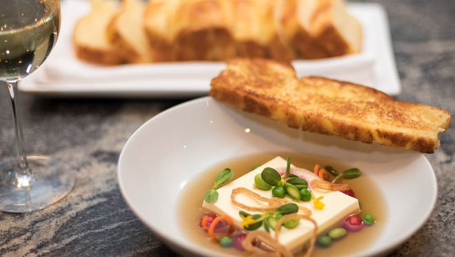 Chilled shallot custard and sugar snap pea consommé with market spring vegetables, fried shallots and toasted duck fat brioche.
