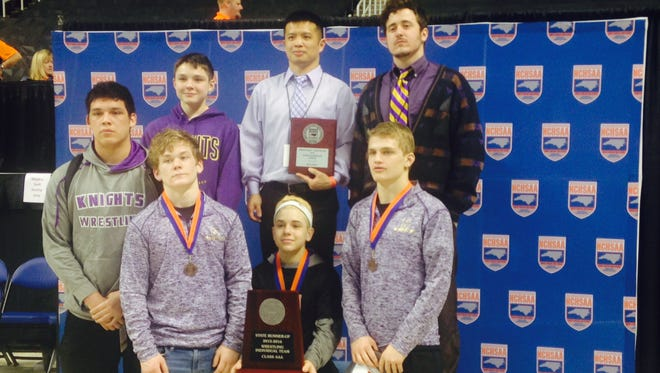 North Henderson freshman Josh Blatt (seated and wearing a headband) and the Knights placed second in the NCHSAA 1-A wrestling tournament on Saturday in Greensboro.