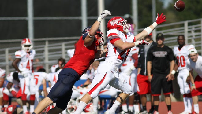 Shippensburg's Tyler Emge, left, defends a pass intended for East Stroudsburg's Devante Robinson. The Red Raiders won 31-14.