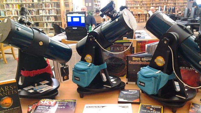 You can check out telescopes at Fountain Hills Branch Library.