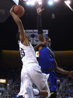 Nevada's Josh Hall goes up for a dunk against San Jose State's Brandon Mitchell on Wednesday. Hall was injured on the play.
