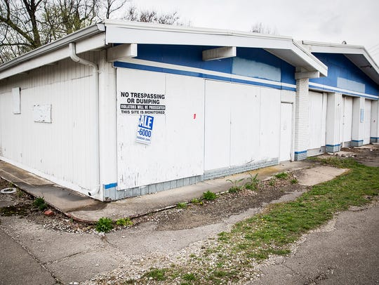 The city plans to demolish a former Marathon gas station