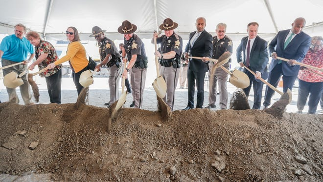 Community officials and leaders take scoops of dirt during the groundbreaking ceremony for the new Community Justice Campus in the Twin Aire neighborhood of Indianapolis on Thursday, July 12, 2018. The campus will house the new jail, courthouse, Sheriff's Office, and an Assessment and Intervention Center.