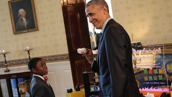 President Barack Obama meets with Jacob Leggette while touring exhibits at the White House Science Fair April 13, 2016. Obama announced Thursday he is taking Leggette's suggestion to launch a kids' science advisory board.