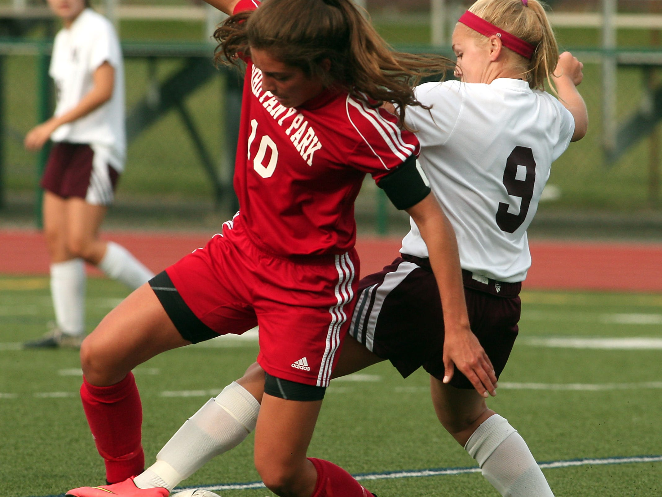 Whippany Park's Gina DelloRusso, l, and Madison's Emily Pruzik battle for the ball during their girls soccer matchup. September 22, 2015, Madison, NJ.