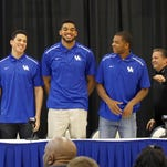 Kentucky's Devin Booker and the rest of the bench cheer on their teammates. April 4, 2015