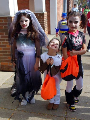 These scary -- and adorable -- young ladies enjoyed last year's Trick or Treat Trail in the village (M. Rosenberry)