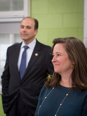 Democrat Shelly Simonds, right, attends a function at Heritage High School in November along with Republican David Yancey. Yancey had a 10-vote lead heading into Tuesday's recount, but Simonds emerged victorious.
