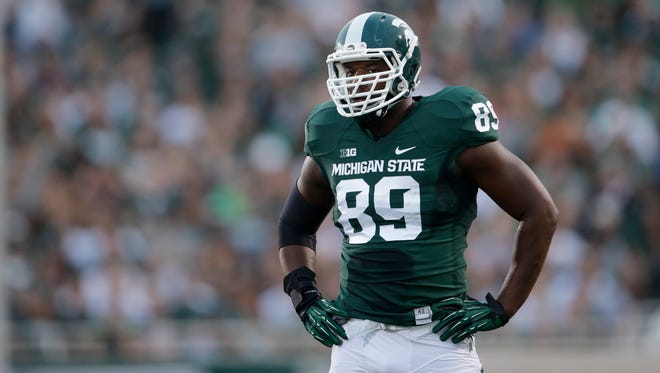 Michigan State defensive end Shilique Calhoun (89) lines up against the Jacksonville State in the first half of a NCAA football game in East Lansing, Mich., Friday, Aug. 29, 2014.