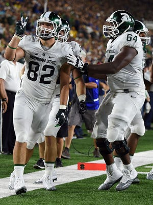 Michigan State tight end Josiah Price celebrates a two-point conversion with guard Brandon Clemons during the first half of MSU's 36-28 win Saturday, Sept. 17, 2016 in South Bend, Ind.
