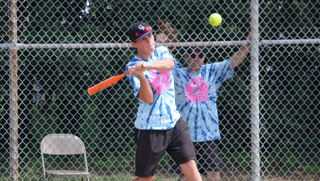 """Connor Lohmiller hits a pitch in the fourth annual """"Eyes on the Prize"""" softball tournament to raise money for the Foundation Fighting Blindness. Lohmiller, a senior at Elder High School, was diagnosed with Stargardt disease in 2013."""