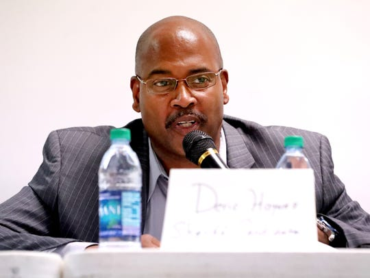 Rutherford County Sheriff's candidate Deric Haynes (I), answers questions at a public forum held by the NAACP, to get to know the candidates on Thursday June, 14, 2018, at Allen Chapel, in Murfreesboro.