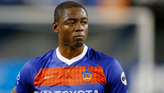 FC Cincinnati forward Fanendo Adi (9) stands at midfield at the USL soccer match between the FC Cincinnati and the Nashville SC at Nippert Stadium in Cincinnati on Saturday, Aug. 4, 2018. FC Cincinnati gave up a late goal and settled for a 1-1 tie against Nashville.