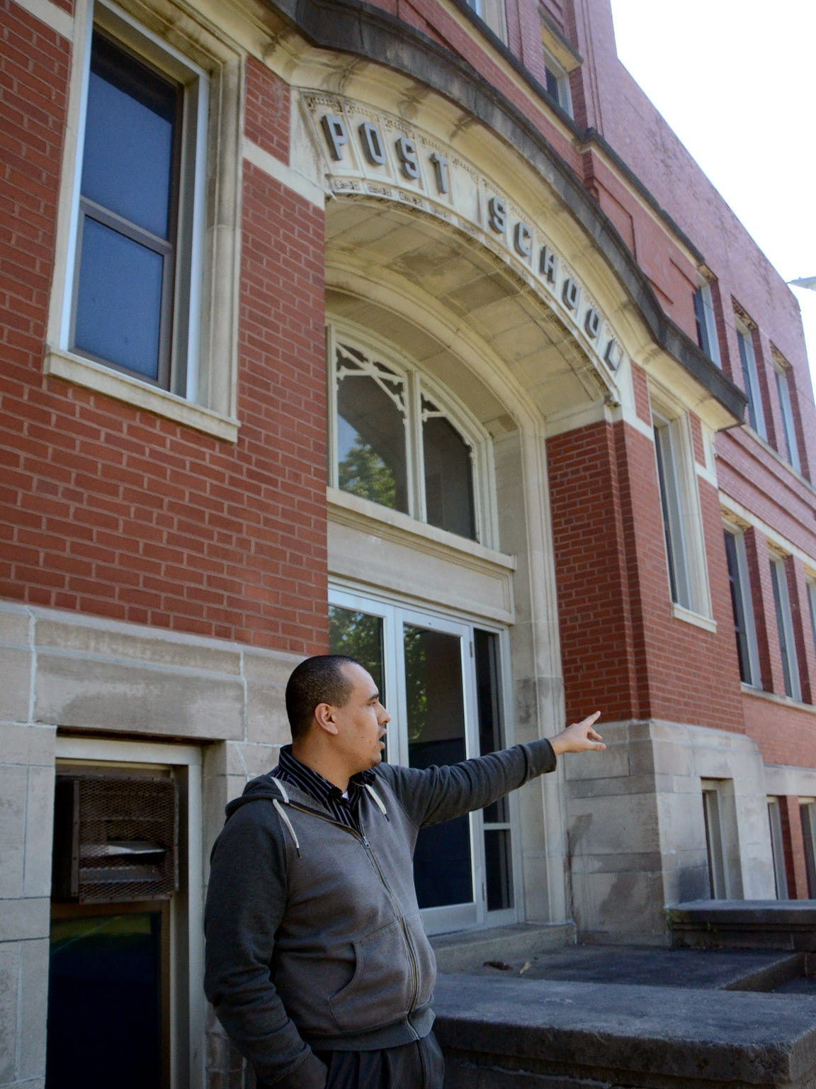 Devon Gibson stands in front of the former Post School,