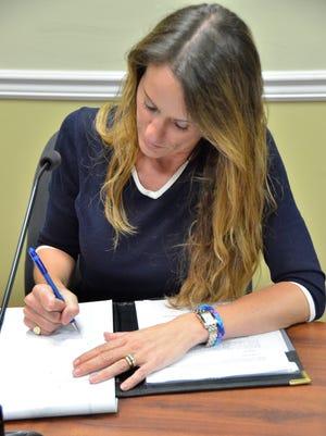 Jennifer Kiernan in her seat at her first Verona Council meeting as the municipal clerk on Monday, Aug. 11, 2014.