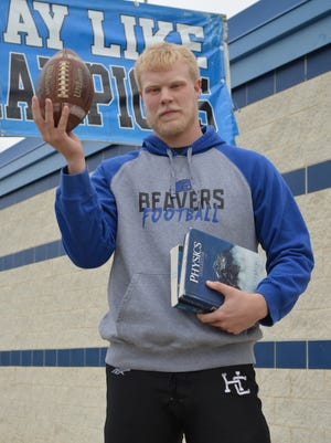 Harper Creek's Ryan McCafferty balances football and academics as is the biggest football player in the city at 6-foot-9, 289 pounds, but also probably the smartest with an SAT score of 1390.