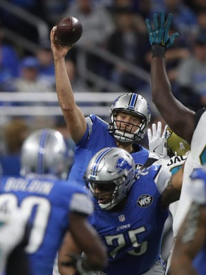 Detroit Lions quarterback Matthew Stafford passes against the Jacksonville Jaguars during second half action Sunday, November 20, 2016 at Ford Field in Detroit.