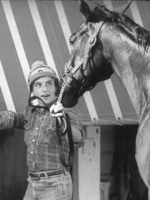 Ronnie Franklin with horse Spectacular Bid in April 1979.