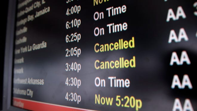 Newark flights are shown as 'canceled' on a flight display board at Chicago O'Hare International Airport on Feb. 1, 2014.