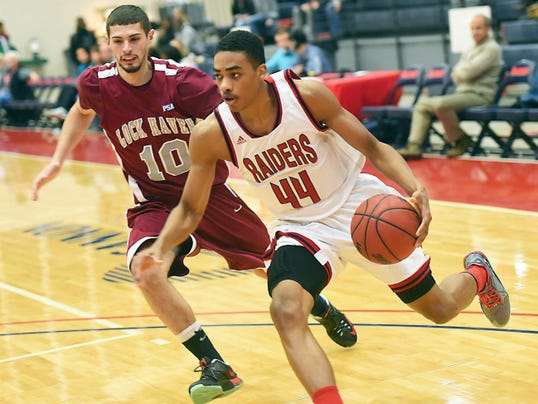 Jay Hardy (44) of Shippensburg drives hard to the basket during a game against Lock Haven in January. Hardy is one of four returning starters to the Raider men's basketball team.
