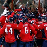 The Washington Capitals celebrate after Game 7 in the first round of the NHL hockey Stanley Cup playoffs against the New York Islanders, Monday, April 27, 2015, in Washington. The Capitals won 2-1, to advance. (AP Photo/Alex Brandon)