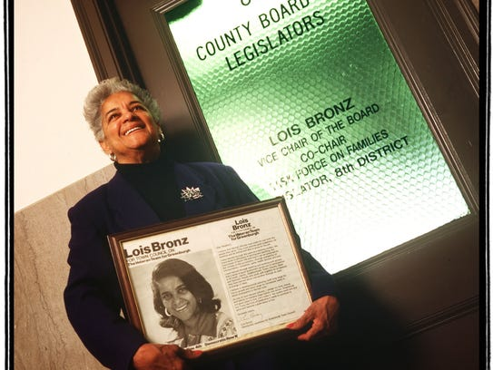 Lois Bronz, in 1999, holds a leaflet from her first