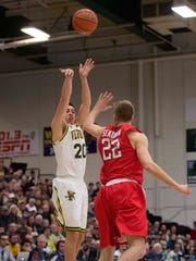 The University of Vermont's Ernie Duncan sinks a 3-pointer over Stony Brook's Bryan Sekunda in Burlington on Saturday, January 30, 2016.