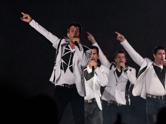 New Kids on the Block, Boyz II Men, and Cincinnati's own Nick and Drew Lachey, Justin Jeffre and Jeff Timmons performed during the Package Tour stop at U.S. Bank Arena. New Kids on the Block perform.