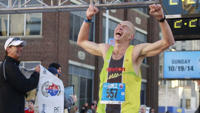 Michael Andersen of Walled Lake finishes in first place for the full marathon during the 37th Annual Detroit Free Press/Talmer Bank Marathon in Detroit on Sunday, Oct. 19, 2014.