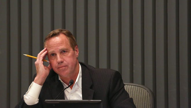 Palm Springs Mayor Steve Pougnet listens during Wednesday's council meeting to public comments.