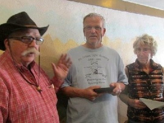 Socorro Chapter Back Country Horsemen members John Young and Jane Farmer gave Mike Bilbo,, center, a commendation.