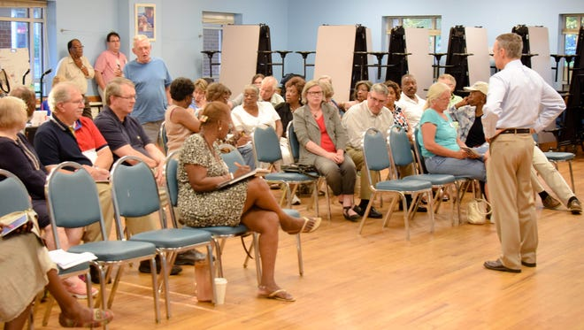 Democratic congressional candidate Andy Millard, standing at right, listens to a question or comment during a recent town hall meeting in Gaston County in this photo supplied by his campaign. Millard plans a similar event Thursday in Black Mountain.