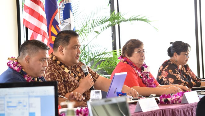 Tinian Mayor Joey San Nicolas, holding the microphone, addresses municipal leaders during the 24th General Assembly of the Association of Mariana Island Mayors, Vice Mayors and Elected Municipal Council Members on Nov. 30, 2017, at the Guam Reef and Olive Spa Resort. He is flanked by Chalan Pago-Ordot Mayor Jessy Gogue, Inarajan Mayor Doris Lujan and Dededo Mayor Melissa Savares.
