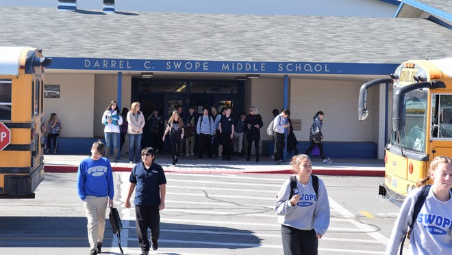 Students leave Swope Middle School on Wednesday, Feb. 21.