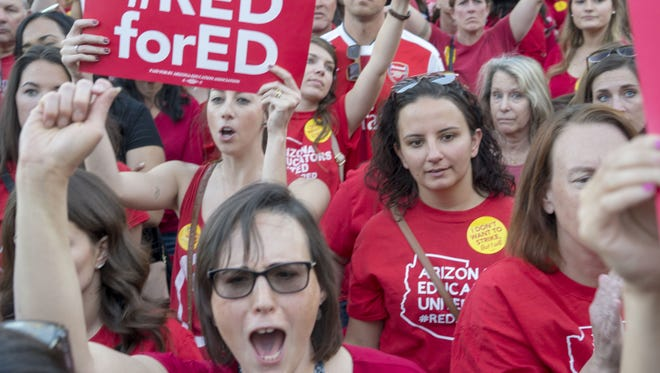 Teachers and their supporters gathered at the Arizona state Capitol on March 28, 2018, to rally for higher teacher pay.